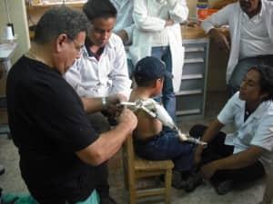 Waldo Esparza from Florida adjusts Jostin's prosthesis