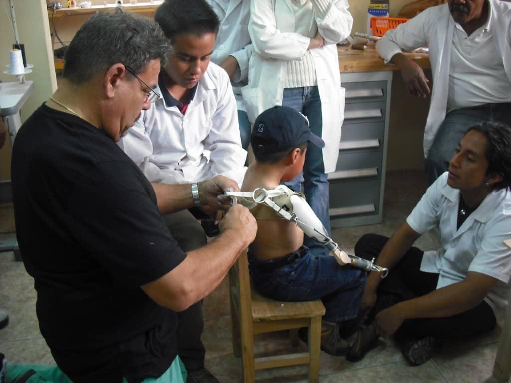Waldo Esparza adjusts Jostin's prosthesis