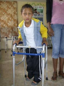 Cristian walks with short-leg braces