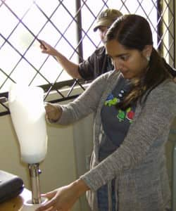 Nina Bondre, volunteer from Duke University, aligns a prosthesis