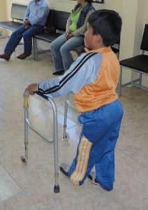 Kevin walks with bilateral long-leg braces