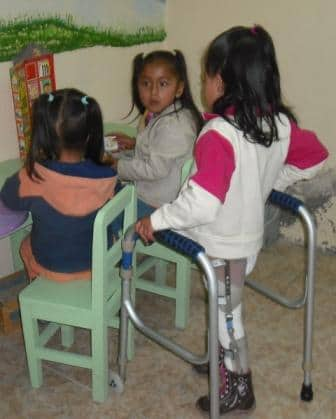 , with spina bifida, walks with long leg braces to join her cousins in play