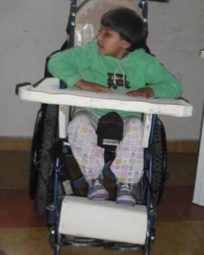 Daisy's wheelchair is adapted with tray, seat, back, laterals, footrest