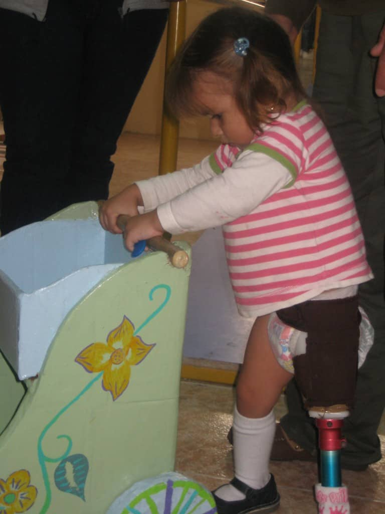 Domenica learns to walk with little cart made from cardboard